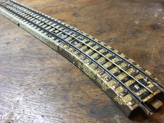 Rail central en laiton